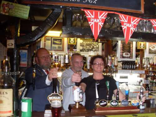 Bob Rowe, (Carnforth mayor) opens Shovel beer festival (with hosts Gary and Louise)