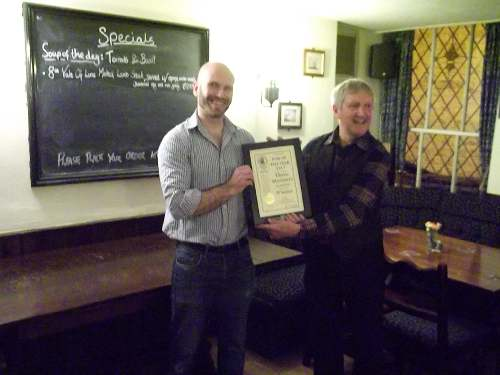 Dom Leighton (left) receiving the certificate from Barry Young