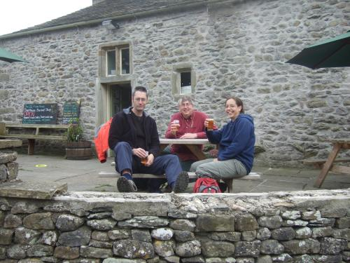 Photo shows three intrepid hikers outside the Old Manor House (Clapham)