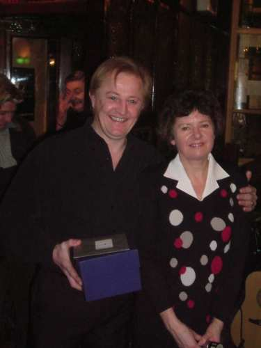30 November 2004: The branch chairman, Jenny Greenhalgh, presents Steve Thorne, the retiring licensee of the John O'Gaunt (central Lancaster), with a tankard in recognition of services to real ale.