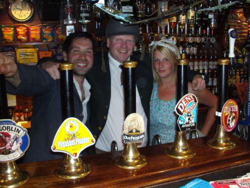 New tenant Owen Edge (centre) with bar staff