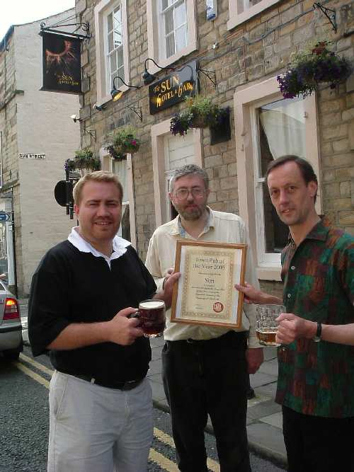 Matt Jackson, proprietor of the Sun, receives his Pub of the Year certificate from Cliff Laine, branch chairman