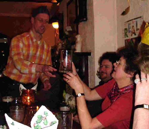 17 Decmber 2005: The current chairman, Chris Laine, presents the past chairman, Jenny Greenhalgh, with an engraved tankard for services to CAMRA